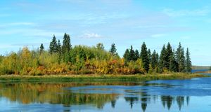 Autumn lake and island Royalty Free Stock Images