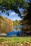 Autumn Lake Landscape. Colorful autumn lake landscape with fall folliage and boat Royalty Free Stock Images
