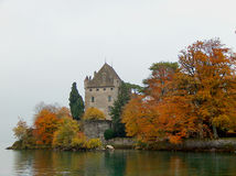 Autumn in the lake. Medieval castle in Yovoire, a beatuful village in Leman Lake royalty free stock photo