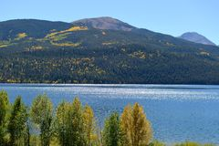 Autumn Lake and Mountains. Autumn view of Twin Lakes area, Lake County, Colorado, United States. Two mountain peaks are: Quail Mountain, in the middle behind the Stock Image