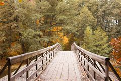 Autumn lake with an old wooden bridge Stock Photography