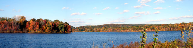 Autumn Lake Panoramic. Autumn colors glow in the late afternoon sun at the lake; panoramic Royalty Free Stock Image