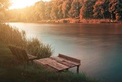 Autumn lake. Pier on autumn lake shore Royalty Free Stock Photography