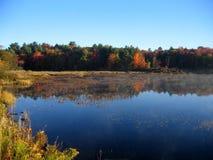 Autumn lake reflection. In Muskoka stock image