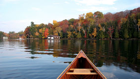 Autumn lake reflection with a canoe. In the Muskoka region of Canada Stock Image