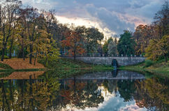 Autumn lake with stone bridge at evening Royalty Free Stock Photography