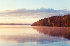 Autumn lake in sunrise. Autumn morning lake in sunrise Stock Photo