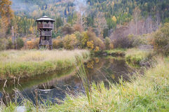 Autumn Lake Tower. Wildlife wooden observation tower stands near lake with reflection and autumn colours. Creston, BC, Canada Royalty Free Stock Photo