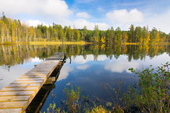 Autumn lake and wooden bridge Stock Images
