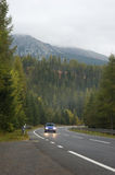 Autumn land road in mountains. Autumn road in mountains / High Tatra landscape, Slovakia, Europe Royalty Free Stock Images