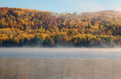 Autumn landscape. Picture of a colorful autumn landscape with morning fog Stock Photos