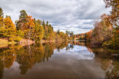Autumn landscape. Lake, forest and clouds Stock Photography