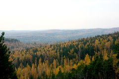 Autumn landscape. View on autumnal forest from apex of mountain Stock Photos