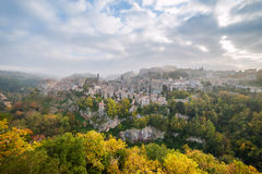 Autumn Landscape with Ancient Town. Autumn landscape with view on ancient town Sorano, Tuscany, Italy royalty free stock photos