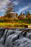 Autumn Landscape. Beautiful colorful autumn landscape. In the foreground is flowing waterfall stock image