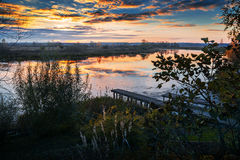 Autumn landscape with bridge. This autumn landscape with bridge and reflections Stock Photo