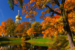 Autumn landscape with church. Autumn landscape with orthodox church and the lake Stock Photo