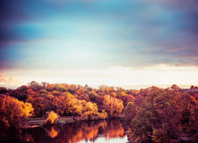 Autumn landscape of  City Park with colorful trees , lake and sky at sunset Stock Photo