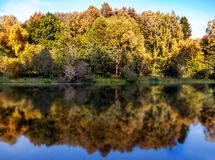 Autumn landscape with colorful forest. Solar amber paysage. Indi Stock Image