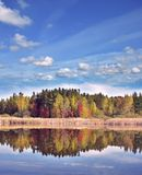 Autumn landscape with colorful trees. Near lake with reflection stock photography