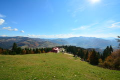 Autumn landscape with cottage and mountains Royalty Free Stock Photography