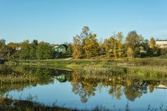 Autumn landscape. Countryside. Reflection in the surface of a po Royalty Free Stock Image