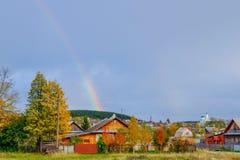 Double rainbow above sunflower field, Autumn, Russia. Autumn landscape: a double rainbow after the rain over the village Royalty Free Stock Photos