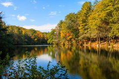 Autumn scene reflected in Burr Pond stock images