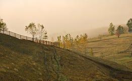 Autumn landscape with fog Stock Image
