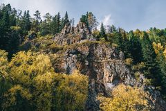 Autumn landscape. Forest, river, stones, rock, leaves. royalty free stock photos