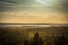 Autumn landscape, forest in a sunset light in Ogre Blue hills pa. Rk, in Latvia Royalty Free Stock Image