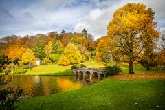 Autumn landscape with golden yellow, orange and green trees in Stourhead, Wiltshire,. UK on 8 November 2018 royalty free stock photos