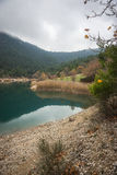 Autumn landscape with green waters of lake Tsivlos, Peloponnese, Royalty Free Stock Images