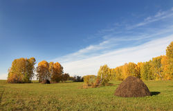Autumn landscape with haycock on a field Royalty Free Stock Photography