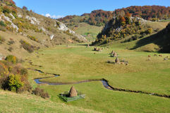 Autumn landscape with haystacks in a valley Stock Images