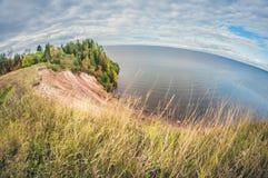 Autumn landscape. high cliff on lake. fisheye distortion lens. Autumn landscape. high cliff on the lake. fisheye distortion lens stock photography