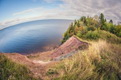 Autumn landscape. high cliff on lake. fisheye distortion lens royalty free stock photo
