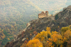 Autumn landscape with high mountain castle church Royalty Free Stock Photo
