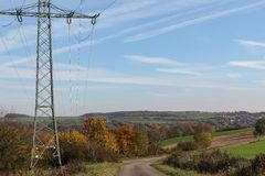 Autumn landscape with a high-voltage Tower in the foreground stock image