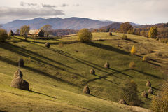 Autumn landscape hills in Romania County, traditional village Stock Photography