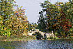 Autumn landscape with a Humpbacked bridge. Gatchina Palace and Park. Russia stock photos