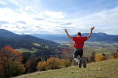 Autumn landscape with jumping man Stock Photo