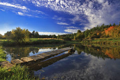 Autumn landscape with lake. And small pier Stock Photo
