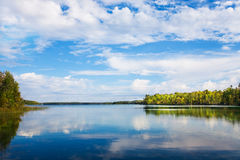 Autumn landscape with  lake and autumn trees. Autumn landscape with  lake, autumn trees and blue sky reflection in the water. Kawartha lakes, Ontario Royalty Free Stock Images