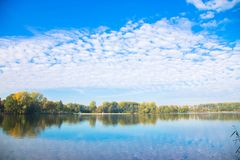 Autumn landscape. Lake in the fall forest. royalty free stock photography