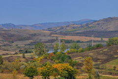 Autumn landscape with lake and hills Stock Image