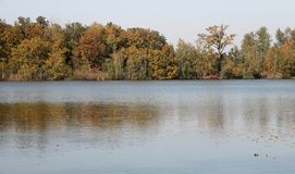 Autumn landscape with lake and trees.  stock photo