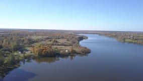 Autumn Landscape Lakes Serokotnya. Peninsula, forest and village