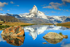 Autumn landscape with Matterhorn peak and Stellisee lake,Valais,Switzerland. Amazing panorama with Matterhorn at morning and beautiful alpine lake,Stellisee Stock Photography