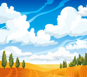 Autumn landscape with meadow and trees. Autumn landscape with yellow meadow and green trees on a blue cloudy sky Royalty Free Stock Photo
